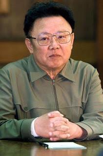 kim jong il seated - Biografi Kim Jong Il